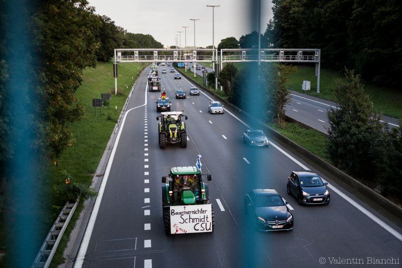 Column of tractors on the E40 highway towards Brussels, Belgium. A huge european protest with farmers from Europe will take place the day after. More than 2000 tractors are expected in Brussels. September 6th, 2015. © Valentin Bianchi