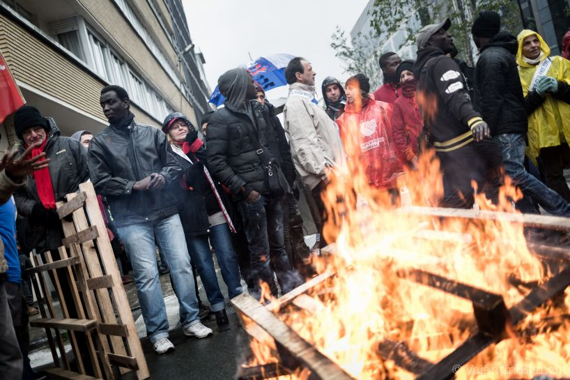 Demonstrators light a fire with wooden palettes outside of an EU summit in Brussels on Thursday, Oct. 15, 2015. Demonstrators blocked roads around the summit, where leaders were meeting nearby, to protest agains the Transatlantic Trade and Investment Partnership and European migration policies. (AP Photo/Valentin Bianchi)